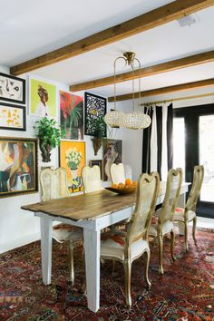 dining room with exposed ceiling beams and gallery wall