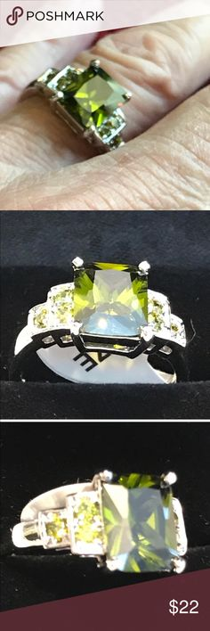 """~Green~ 10k White Gold Olive Green Olive green stone in a 10 karat white gold setting. NWT Size 8. Main princess cut stone with smaller stones at sides of ring. Approximately 1 x 1 x .25"""".  Thanks for rounding on my closet! ✨💜 V/hk Jewelry Rings"""