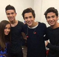 This is a picture of Austin(the boy in the middle) and a few other people who look very similar to him.