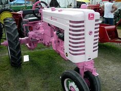 """Pink John Deere Tractor, for the country girl in all of us! """"What is it with ALL these Deere Tractors? Jd Tractors, John Deere Tractors, Pink Tractor, John Deere Equipment, Antique Tractors, Vintage Tractors, Old Farm, Everything Pink, Farm Gardens"""