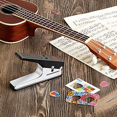 "Pick Punch - he Pick Punch®️️ does exactly what it sounds like "" it takes materials, like old credit cards or unused gym membership badges, and punches them into custom guitar picks. - [ad]"