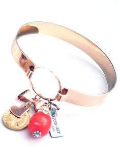 Rose gold bangle with coral and crystals