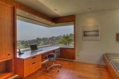 Modern desk near a corner window