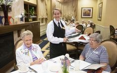 At Springhouse Estates, Kelsey Roy, 17, of Horsham, waits on Ruth Leslie (left) and Marcia Bobman. To sweeten the deal, Springhouse offers culinary scholarships for each student.