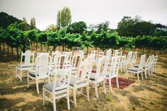Avenue Twelve Rentals Styled Wedding Ceremony in San Luis Obispo. White Mismatched Chairs. Aisle Runner. www.avenuetwelve.com