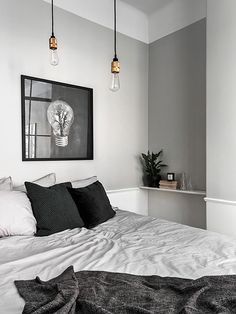 Decorate with black, white, and gray for a cozy but minimalist look in the bedroom. The key is incorporating different textures.