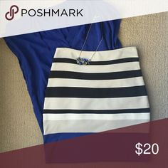 Express striped pencil skirt Express stretchy pencil skirt with black, cream, white, and blue stripes. Zips up the side. 65% rayon, 30% nylon, 5% spandex. Express Skirts Pencil