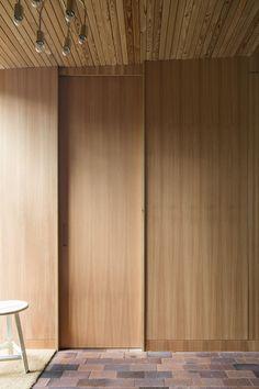Image 13 of 25 from gallery of Villa Ljung / Johan Sundberg. Photograph by Markus Linderoth Veneer Panels, Wooden, Small Cottage, House Design, Gallery, Windows And Doors, Brick Flooring, Villa, Architecture Art Design