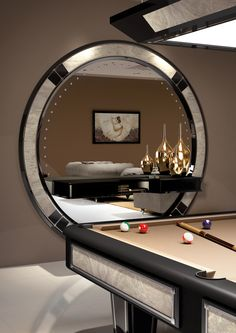 Contemporary pool room entirely furnished by Vismara; complete of Pool Table and Stargate Big Mirror with Indian Saver Marble decorations. #vismaradesign #luxuryfurniture #italianfurniture #polltable #gameroom #pooltable #desirecollection