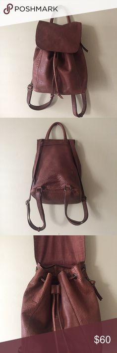 Urban Outfitters Brown Genuine Leather Backpack 100% Buff Cow Leather Outer and 100% Cotton Lining. Great used condition! Shows a little natural wear and tear and a small white stain (may come out easy - haven't tried to clean because I don't want to ruin the leather finish). Urban Outfitters Bags Backpacks