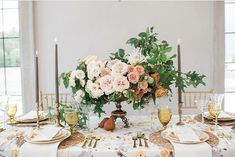 romance with a dash of drama with this asymmetrical arrangement of gold tableware peachy pink English roses - wonderful!
