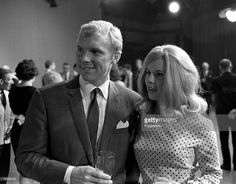Sport, Football, London, England, 31st July 1966, England captain Bobby Moore is pictured with his wife Tina at a lunch reception the day after England had beaten West Germany 4-2 after extra time at Wembley in the World Cup Final