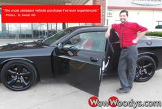 "Phillip Lacrocco from St. Joseph, Missouri purchased this 2014 Dodge Challenger and wrote, ""I have shopped at numerous dealerships for the right car...and the right deal. The staff at Woody's not only delivered both of those things to me, but they did it with an unparallelled level of service that only years of successful experience can bring to the table. It was the most pleasant vehicle purchase I've ever experience, and it took little time to boot! Bravo Woody's!"""