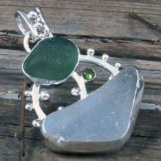 Green and clear sea glass pendant, via Flickr.