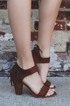 pair of faux suede heels with toe and ankle strap, zippered back, and a stacked wooden heel
