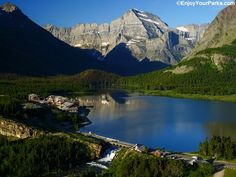 A view of Many Glacier Hotel, as well as Swiftcurrent Lake and Mount Gould towering above it, in Glacier National Park.