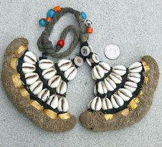 India | An old head or hair ornament from the Naga tribe | Made from cowrie shell, buttons, glass beads, plant fiber and cotton.