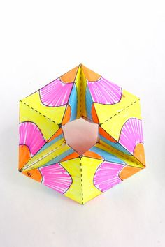 Make this paper toy and be mesmerized by the colorful action! Based on flexagons and kaliedocycles.