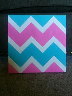 DIY canvas art: Chevron. acrylic paint. Marked off lines with blue painter's tape.
