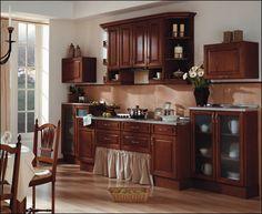 Cocina con puertas de castaño plafonadas color nogal difuminado