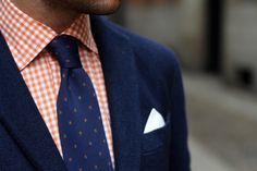 Blue tie on orange checked shirt