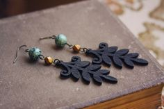 zara.  a pair of black wooden leaf earrings. by RootsandFeathers, $24.00