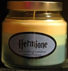 fandom scented candles: Hermione (New parchment, fresh cut grass and spearmint toothpaste.)