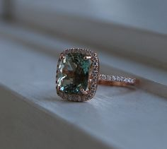 3.34ct Jasmine green Aquamarine halo diamond ring cushion cut 14k rose gold engagement ring. $1800,00, via Etsy.
