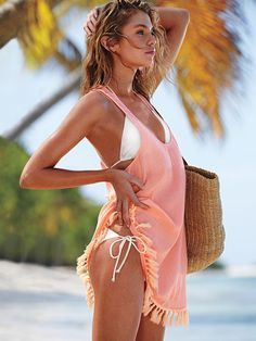 Those boho tassels, that breezy shape...just throw this over your bikini for instant free-spirited vibes. | Victoria's Secret Tassel Cover-up Tunic
