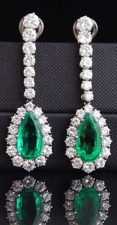 Emerald Diamond Earrings. Important pendant earrings from the 1970s, set with gem quality old mine Colombian emeralds of 8.67 carats and diamonds of circa 7.5 carats.