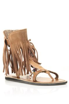 Different Designs of Gladiator Sandals came out! This was one design that became popular as a boho style, sandals with a fringe.