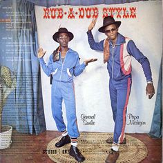 Michigan and Smiley (1980) Pants in socks and towel on the shoulder. First generation dancehall and roots of hip hop.