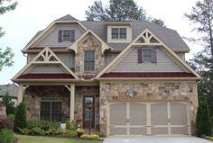 Craftsman Exterior of Home with exterior stone floors, Eldorado Stone Rough Cut, Fence