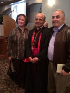 Maria Saleh and brother with Bishop Zaiden