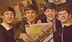 "The Beatles posing with their debut studio album ""Please Please Me"" released by Parlophone, 1963"