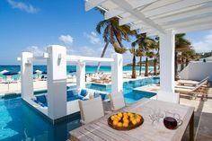 View of the pool and beach at villa Nautilus! Indoor Outdoor Living, Outdoor Living Areas, Outdoor Decor, Beach Furniture, Beach Club, Luxury Villa Rentals, Sliding Glass Door, Glass Doors, Beach Design