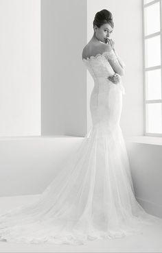 Pretty silhouette of a Rosa Clara lace off the shoulder wedding dress