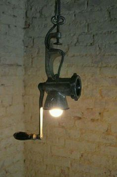 To Transform Simple Kitchen Utensils Into Light Fixtures How about a pendant light made from a meat grinder?How about a pendant light made from a meat grinder? Rustic Lamps, Rustic Lighting, Industrial Lighting, Kitchen Lighting, Industrial Style, Lighting Ideas, Industrial Windows, Task Lighting, Rustic Decor
