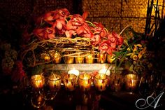 pink orchids with willow branches and candles centerpiece at Westchester ...  allegrophotography.com