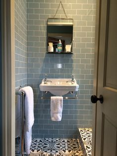 Bedroom 2 - Ensuite Shower Room. Burlington Edwardian Cloakroom basin, M&S vintage style hanging mirror, Fired Earth Pont Neuf encaustic floor tiles & Retro Metro Atrium blue crackle glaze wall tiles. Carron Bassingham towel radiator.