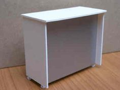 1/12th scale., This compact Reception Desk, finished in white with a 'silver' front panel, is a good 'front' for your miniature Hair Salon or Beauty Parlour.