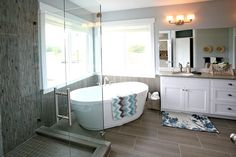 mosaic shower tiles, free-standing tub, natural light