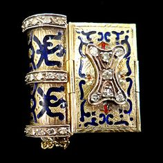 This 14 k yellow gold Victorian book bracelet features 38 diamonds (I-J, color. SI2-I, clarity) with blue and red enamel.  The diamonds weigh ~ 1 cttw.  This unusual bracelet folds up into a book when not worn.  #ebay. Haig's of Rochester.