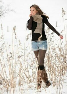 Shorts over leggings and boots? Nice!