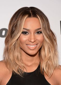 Ciara Medium Wavy Cut - honey-blond ombre waves complement her complexion to a T.