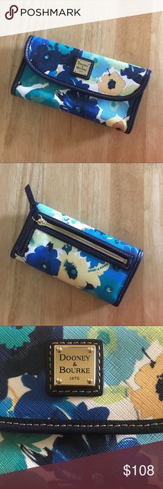 "Dooney & Bourke Floral Somerset Marine Wallet Dooney & Bourke Floral Somerset Marine Wallet. NWOT. Authentic Dooney & Bourke Wallet has a snap front closure, back exterior zip pocket, interior 7 credit card slots and an ID window, plus 3 slip bill pockets. The interior is a beautiful navy blue leather with red accents, exterior has beautiful water color like floral print in blues, yellows, greens and white. Measurements 7"" x 4"" x 1"". Feel free to ask questions. No trades. Dooney & Bourke…"