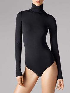 VISCOSE MIXThe seamless turtleneck string body flatters the figure with an exceptionally polished look.  Long sleeves  Extra soft viscose A timeless look finds itself in a basic style.