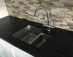 Another Bluci Under mounted stainless steel bowl kitchen sink. Thanks to this customer who sent in this picture. We love the granite worktop with drainer grooves and the unique tiled wall behind the sink! Kitchen Tiles, Kitchen Sink, Designer Kitchen Taps, Sink Taps, Sinks, Spray Insulation, Real Kitchen, Corian, Bathroom Wall