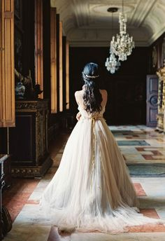 The hand-dyed wedding dresses in this bridal style shoot are to die for! Photo by Laura Gordon