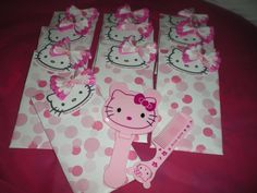 Hello Kitty giveaways for my client Eden.  I made a cute bow using tissue paper and printed gift wrap.